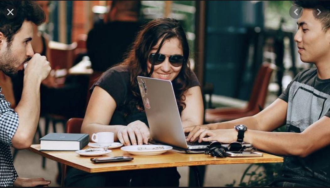 People Sharing Laptop